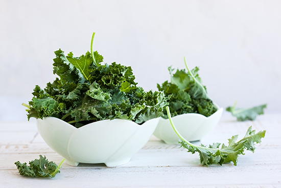 Fresh green kale leaves in bowl